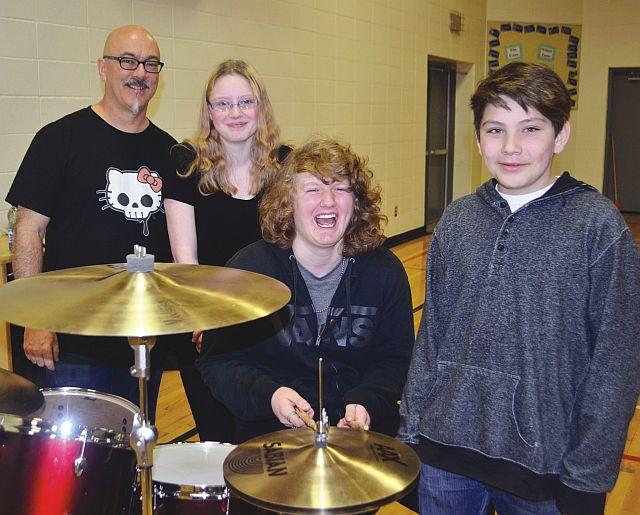 Crash Test Dummies drummer Mitch Dorge, left-right, with Prairie River Junior High School students Desiree Bissell (Grade 8), Dakota Ehrler (Grade 9) and Domitri Noskey (Grade 7).