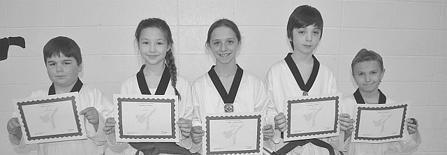 Awards for best skills were presented to several Scorpions. Left-right are Tarek Laurin for best board break, Braelyn Dallaire for best patterns, Taylor Oliver-Guerin for best overall testing, Zachary Grace for best self-defense, and Hunter Bellerose for best sparring.