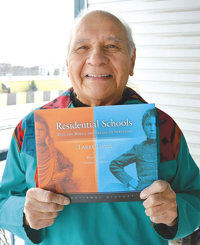 Larry Loyie celebrating the arrival of his most recent book, Residential Schools, With the Words and Images of Survivors, in November 2014.