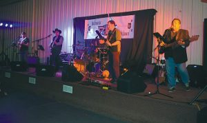 Pictured above is Backwater Breakdown, a local band that performed for the dinner and dance in the Elks Pro Rodeo, north of High Prairie, in the evening of April 16. In no particular order are Cory Fowlie on lead guitar, Rob Pardel for the lead/rhythm guitar, Trevor Kucheruk for rhythm/vocal, Steve Denty on drums and Vince Cunningham on bass guitar. Check the Smoky River Express' Facebook page for a couple of video clips of their performance.
