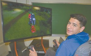 Students placed in driver's seat of simulator