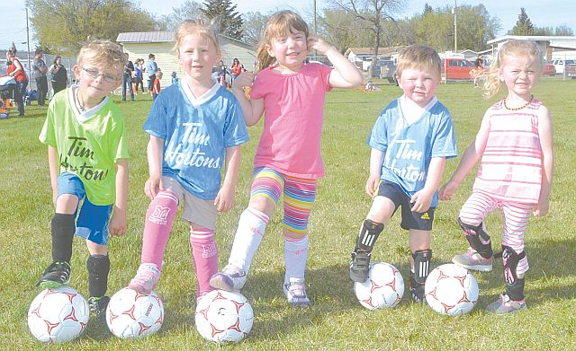 Getting on the ball! Soccer is for people of all ages including four years old and under. Left-right are Jonathan Senkoe, Alaina Steak, Maelle Lewis, Carter Savill and Sarah Cox. All were very eager to start the season.