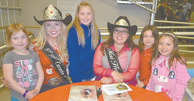 Miss Rodeo Canada Samantha Stokes of High Prairie, second from left, was a special guest during the rodeo with Miss High Prairie Elks Pro Rodeo Jessica Lavoie, third from right. Left-right are fans Kalliope Wong, 5, Stokes, Hannah Turcotte, 10, Lavoie, Gillian Blackhurst, 7, and Sidney Turcotte, 7.
