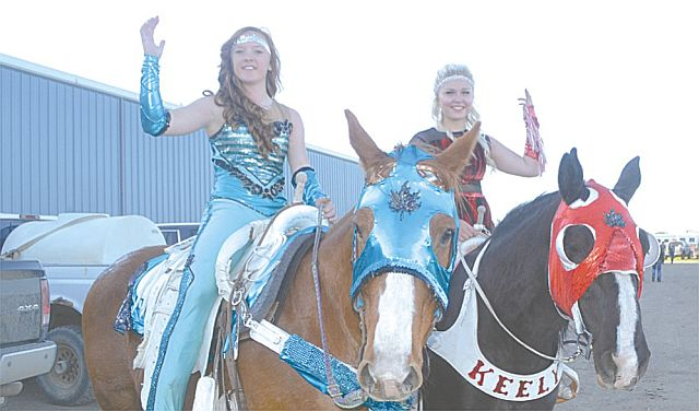Trick riding by Mackenzie Calhoon, left, of High Prairie, and Keely Wamstreeker, of Grande Prairie, wowed the crowd with their unbelievable manoeuvres with the horses.