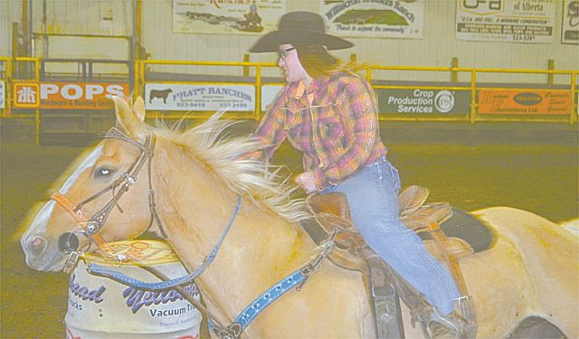 Madison Conrad of High Prairie rounds the turn in local barrel racing at the rodeo Saturday night. She finished first in the event. Local barrels is held to give area residents a chance to compete.