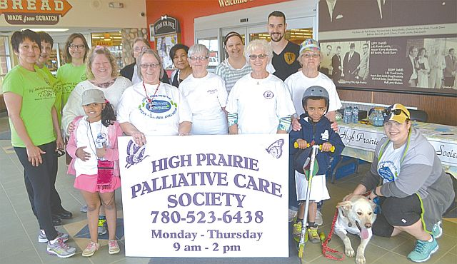 High Prairie Palliative Care Society gets ready to start the walk. Palliative Care co-ordinator Debra Isert, front row, second from left, is behind the sign.