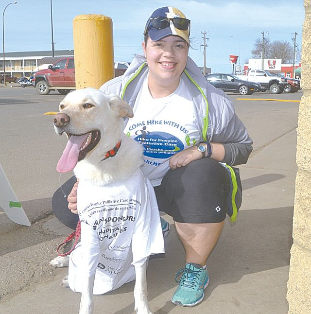 Pamela Wood gets ready to walk with her dog Ryker. T-shirts are given to all participants in the hike.