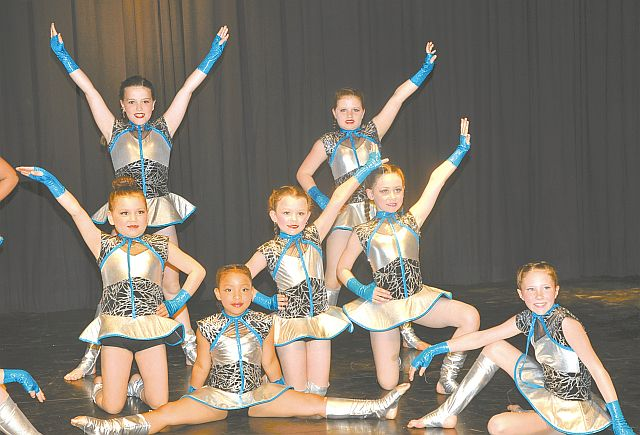 These girls have power! The High Prairie Repertoire Dance Society held three recitals May 6-8 to highlight dancers' achievements. One group danced Bionic Atomic, a beginner acrobatic dance choreographed by Leah Serhan. Dancers are usually selected with previous gymnastics experience. In the front row, left-right are Angelene Richards and Aislinn Drefs. In the middle row, left-right, are Keya Willier, Casey Billings and Morgan Jones. In the back row, left-right are Hannah Haas and Mischa Deering. Not shown are Ashley Billings, Emma Callio and Romie Emter.