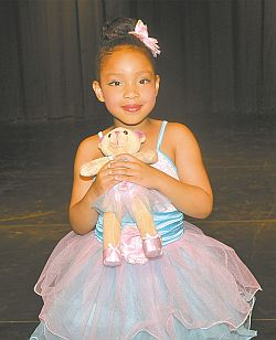 Angelene Richards is a cute as the doll she is holding in The Great Toy War, a beginner ballet choreographed by Zoe Barrons. The dance won three awards.