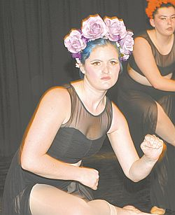 Zoe Barrons, foreground, and Jessica Smith perform a modern dance called Dia de las Muertos.