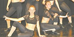 Darbie Billings, left, and Madison Price perform with other intermediate/advanced jazz dancers in Confident, choreographed by Leah Serhan. The dance won two gold and a silver at recent dance festivals.