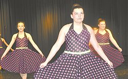 Booty Swing was a colourful dance featuring novice tap dancers. Left-right are Madison Price, Jessica Smith and Tanasity Smith. The dance won a high silver and two silver awards.