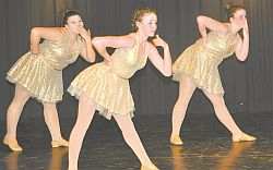 Repertoire dancers blow kisses to the audience during their performance of Emergency, a junior jazz dance. Left-right are Tanasity Smith, Rhys MacIntosh and Jennifer Barrons. Emergency won a gold and two silver at recent dance festivals and choreographed by Leah Serhan.