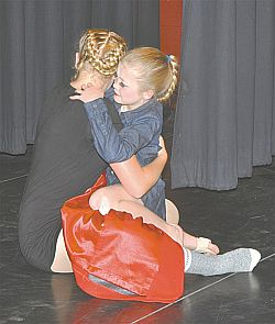 The Red Coat told a touching story that ended when Grayce Keay, left, hugged Charlotte Boerchers.