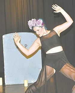 Zoe Barrons dances in front of a tombstone in Dia de las Muertos, a modern dance.