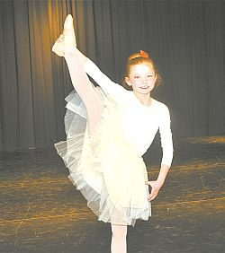 Charlotte Boerchers shows you have to be nimble to perform during a lyrical dance called 99 Red Balloons.