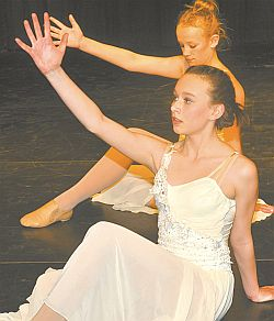 Madison Price, in front, and Darbie Billings dance to the lyrical number Hallelujah, choreographed by Angela Meunier.