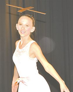 Alexa Prpich wears a cross during her group's performance of Marionette, choreographed by Brianna Panasiuk.