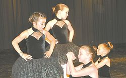 Some are begging while others appear to be in charge. How appropriate for a number called Mission Impossible! Left-right are ballet dancers Tessa Anderson-Noskey, Leah Thompson, Elise Ferguson and Jaiden Barton. Zoe Barrons choreographed the dance.