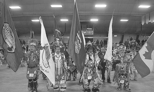 The Grand Entry is led by flagbearers. Left-right are Wayne Burnstick with the Big Lakes County flag, Kirby Chalifoux with the Town of High Prairie, Fred Scanie for the Province of Alberta, and Howard Bruneau with the Canadian flag.