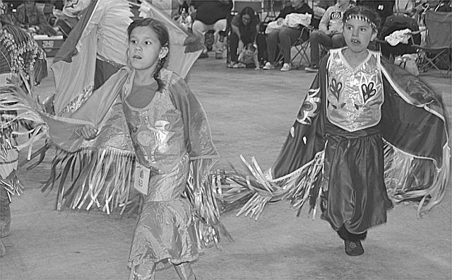 Darrianna Willier, 7, of Sucker Creek, left, and Katana Calliou, 7, of Grande Prairie dance in the Junior Girls category.