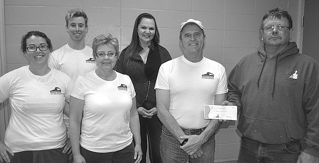 Swim Challenge evening swimmers, left-right, were Laura Cannon, Shane Farnham, Susan Smith, Tina Ostermeier and Wayne Stafford, with Bob Calhoon of Peak Fitness, which donated a one-month membership to all who reached or exceeded the target.