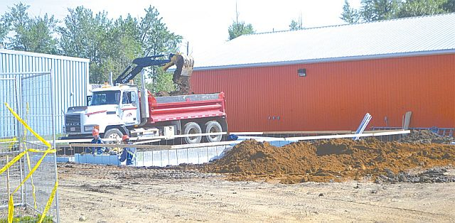 Crews work to construct the foundation of the new office building on the north side of the site.