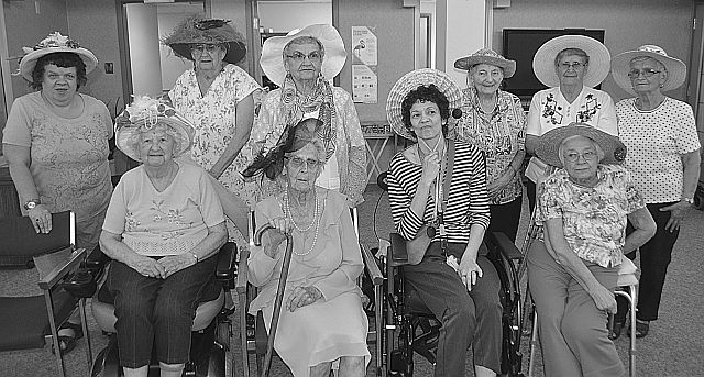Mothers and women on parade! In the front row, left-right, are Rita Turcotte, 92, Louisa Parke, 95, Bernadette Loyst, and Inge Lubeseder, 80. In the back row, left-right, are Deborah Newman, Verda Kozie, 86, Pauline Kushner, 89, Mary Crantz, 89, Ila Sawchyn, 82, and Polly Stafford, 84.