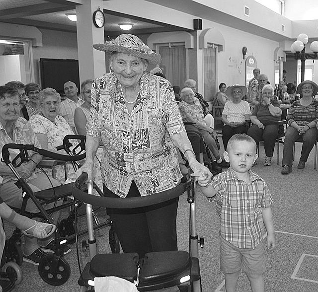Mary Crantz, 89, left, shows off her hat with her great-grandson Kieran Hewko-Dagner, 2.