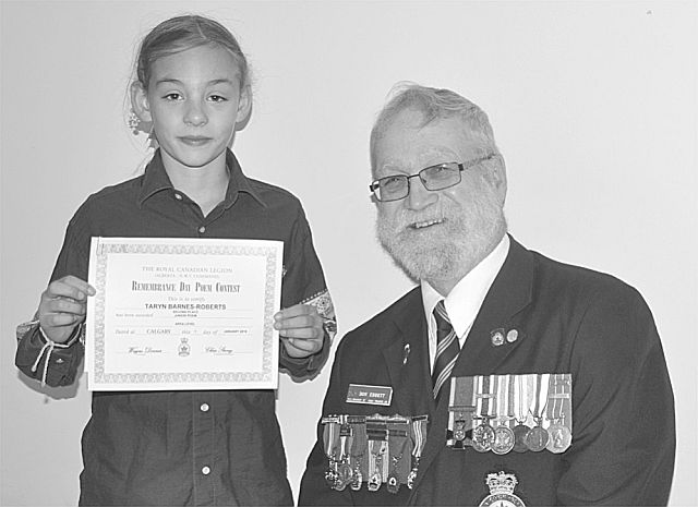 Taryn Barnes-Roberts, left, receives her award from High Prairie Legion president Don Ebbett for placing second in Area Junior Poems. She won $25 and a certificate. Barnes-Roberts attends High Prairie Elementary School.