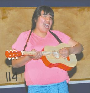 Ashley Stuart played the guitar and sang two songs. Judging by her smile, winning was not important.
