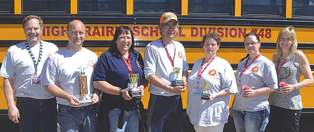 Zone 5 School Bus Roadeo co-ordinator Harry Davis, left-right, with winners in first Jamie Bylyk, second Carmen Pelletier, third Larry Auger, fourth Mary Read, fifth Candace Barber and sixth Myrna Lanctot.