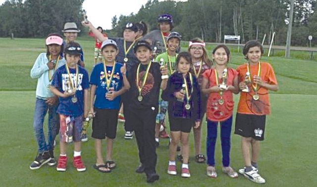 Kids proudly display their medals at the Youth Golf Day.