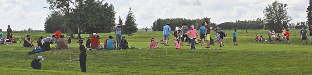 The kids from the Lesser Slave Lake First Nation communities of Sawridge, Driftpile, Kapawe'no, Swan River and Sucker Creek competing in a putting competition.