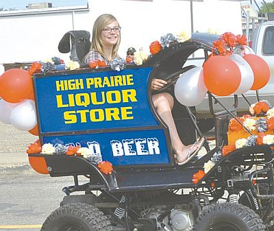 Nicole Stout, an employee at the High Prairie Liquor Store, had the most comfortable seat in the house along the parade route!