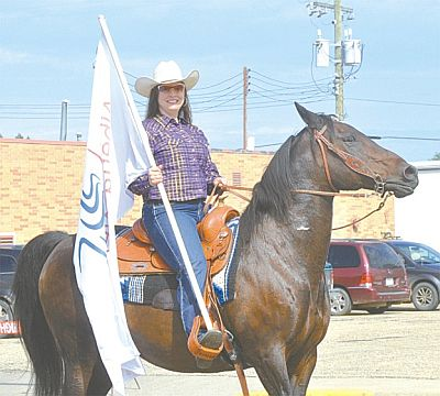 Meghan Payne rides her horse while representing the Lesser Slave Watershed Council. She is the council's executive director.