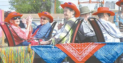 Pleasantview Lodge enters a float in the parade each year and 2016 was no exception. Left-right are hat adorning lodge residents Louisa Park, Theresa Simoneau and Ivy Taylor.