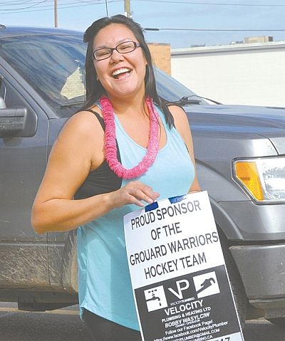 Jennifer Auger was all smiles while handing out candy for the Grouard Community Association. Her husband, Shawn, is the group's president.
