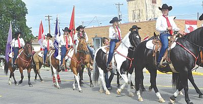 The High Prairie Wranglers are a proud part of the Elks Pro Rodeo. Riders practice many hours for months for the grand entry. Their precision riding always draws cheers from the crowd.