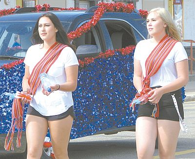 Jackie Gauchier, left, and Chantelle St. Cyr, wear their traditional Metis sashes while representing Peavine Metis Settlement. The Settlement always enters the parade and makes great effort to highlight their culture.
