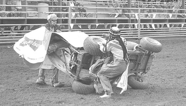 Rodeo clown Ricky Ticky Wanchuk escapes injury after his vehicle tipped on its side during one of his acts at the rodeo.