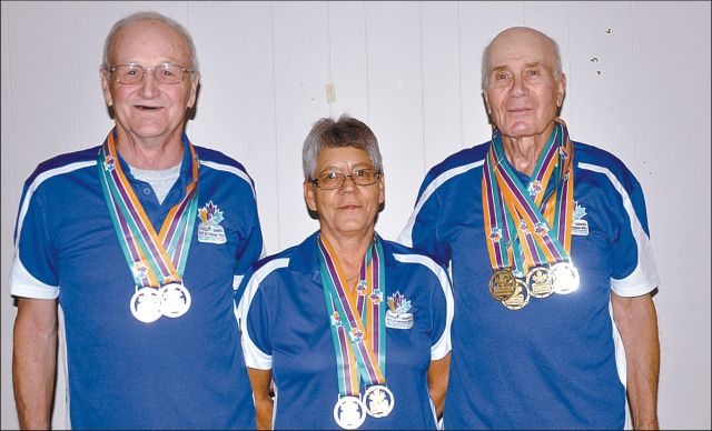 Three area seniors won a total of eight medals at the Canada 55 Plus Games in Brampton, Ont. Aug. 17-18. Left-right are Wendell Ebbett, Evelyn Lesiuk and Frank Tries.
