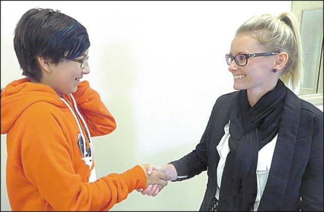 Grade 6 student Lashanda Gauchier, left, welcomes Katie Steenson to Joussard School.