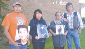 Murder victims' families show photos in court