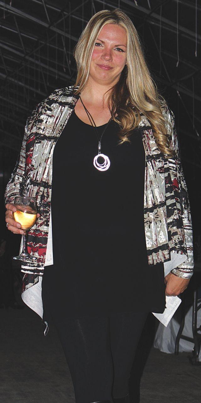 Kristin Rich looks cool and casual in this abstract printed cardigan.