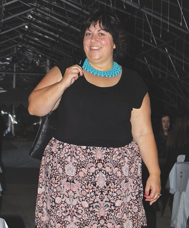 Lucy Girard smiles for the camera as she sashays down the run way in a beautiful turquoise necklace.
