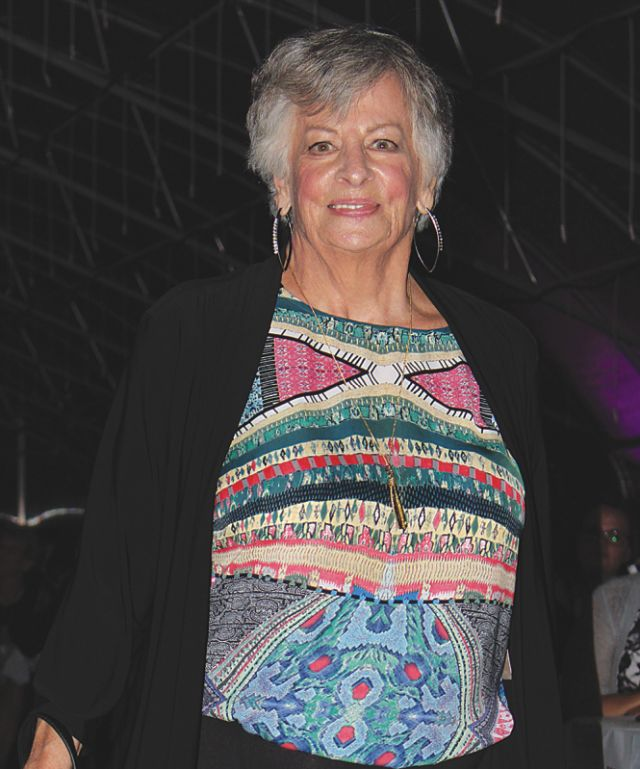 Denise Kemp wears a vibrant bohemian inspired blouse like there is no tomorrow, you go girl!