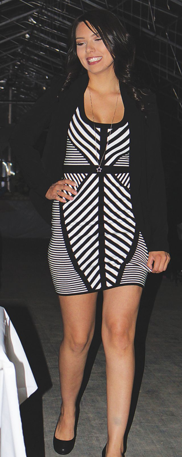 Shenay Bellrose has us seeing black and white in this figure flattering stripped dress.