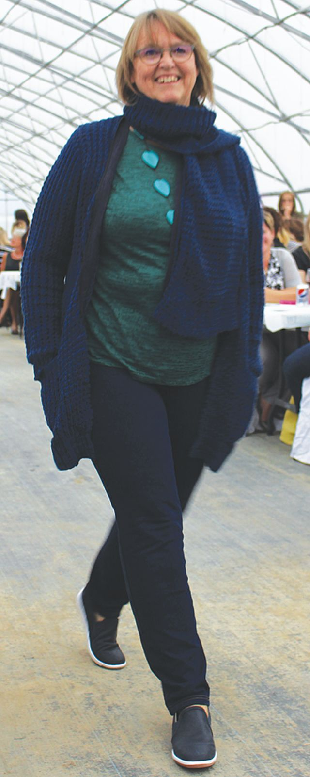 Cathy Wilcox struts her stuff in this casual fall get up with a matching cardigan and scarf.