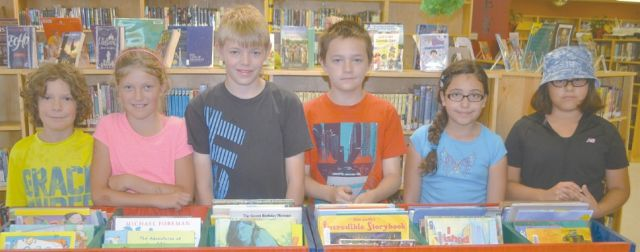 Above are 9-12-year-old members of the TD Summer Reading Club at the High Prairie Municipal Library. Left-right are Sawyer Pratt, Natalie Pratt, Casey Gairdner, Logan Lalonde, Jennifer Grey and Janay New.